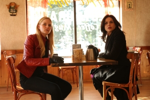 """ONCE UPON A TIME - """"Lily"""" - Emma's potential for darkness is looming over everyone, but when Emma realizes Maleficent's daughter Lily is in fact her closest friend from her foster care days, she resolves to find Lily and reunite her with her mother. Regina joins forces with Emma and together they set out to track down Lily and to warn Robin about Zelena. However, neither of them is prepared for the harsh realities they'll encounter in the outside world. Meanwhile, in Storybrooke, Gold faces a crisis involving Belle. In a foster care flashback, things are looking up for young Emma with her new family until Lily's appearance threatens to destabilize everything, on """"Once Upon a Time,"""" SUNDAY, APRIL 26 (8:00-9:00 p.m., ET) on the ABC Television Network. (ABC/Jack Rowand) JENNIFER MORRISON, LANA PARRILLA"""